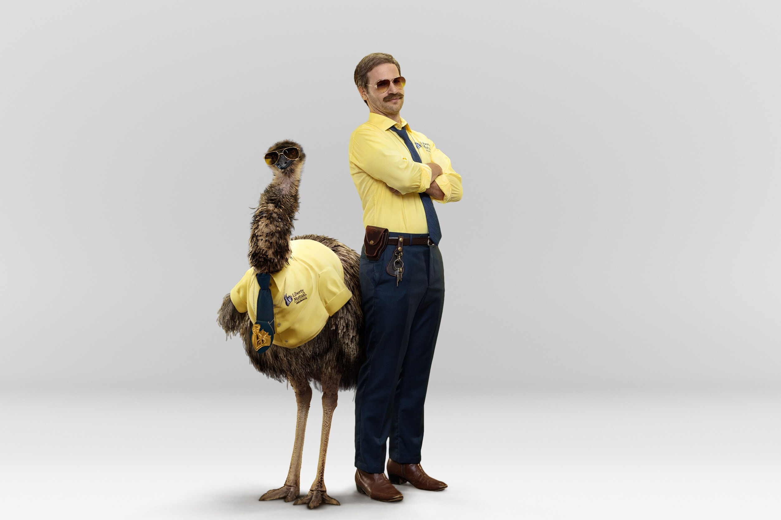 Picture of emu and person