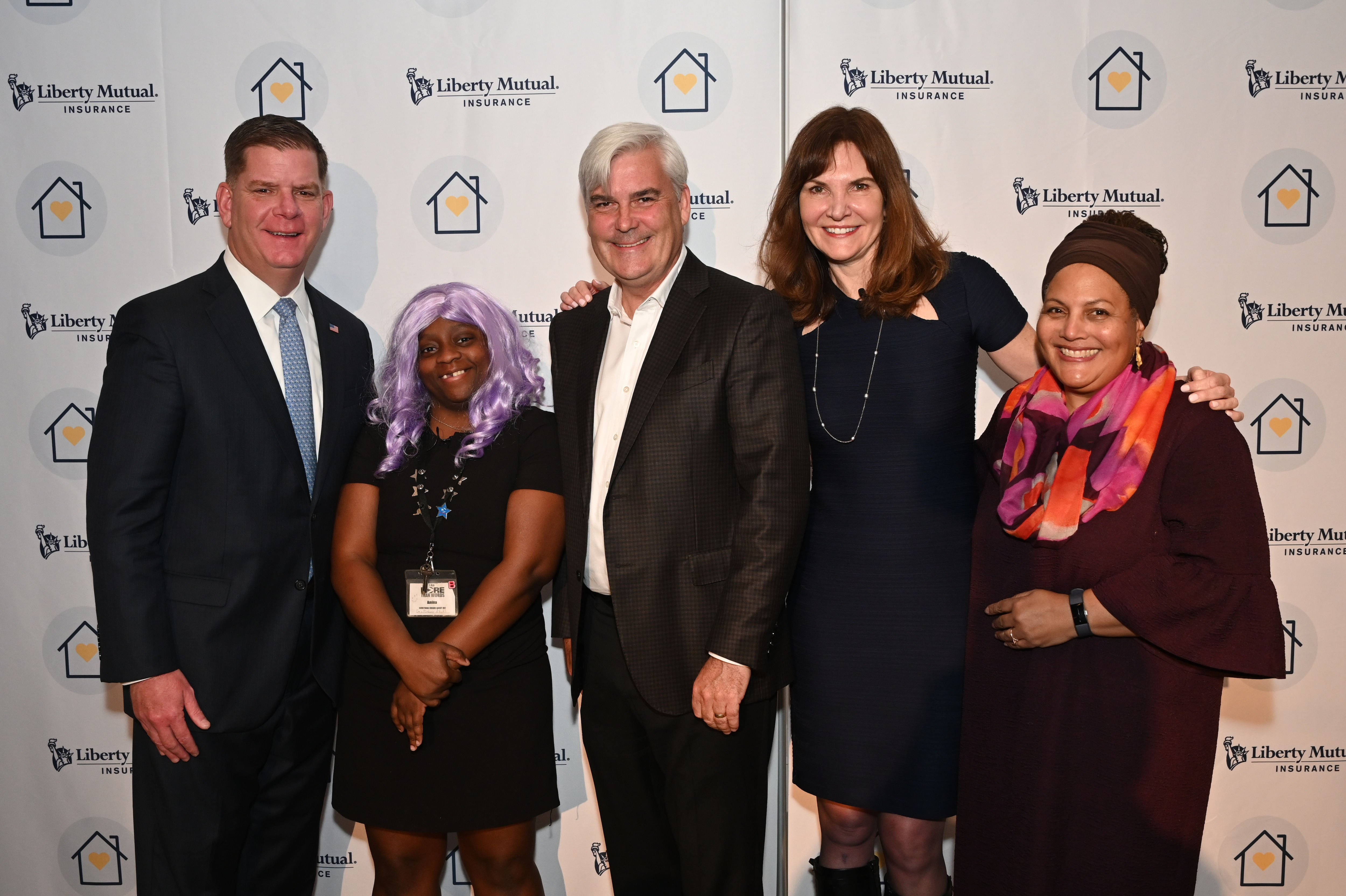 mage of Liberty Mutual CEO and leaders with Boston Mayor Marty Walsh and representative from A Way Home