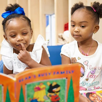 Two young children reading