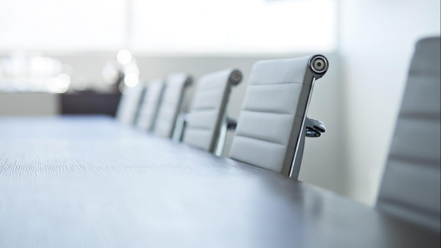 Close up image of chairs in a board room