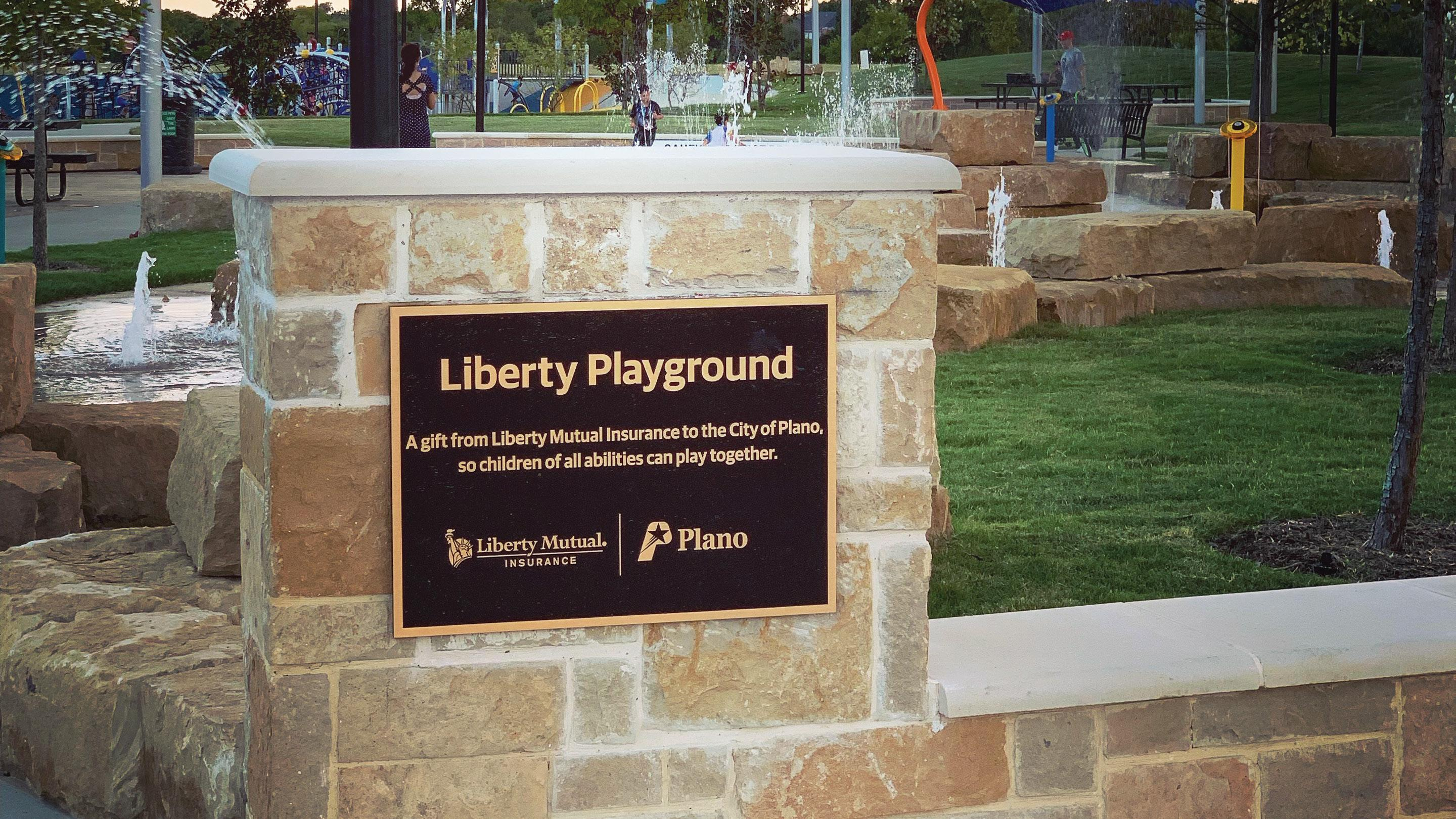 (slide 4 of 8) Image of Liberty Playground sign.