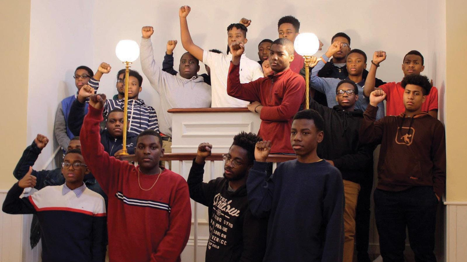 (slide 1 of 4) Group of young black teens with fists raised at The Museum of African American History  .